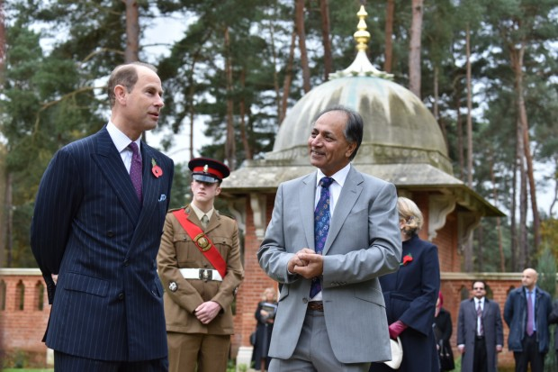 HRH The Earl of Wessex KG GCVO tours the restored Peace Garden with Zafar Iqbal, Project Lead at Woking Borough Council.