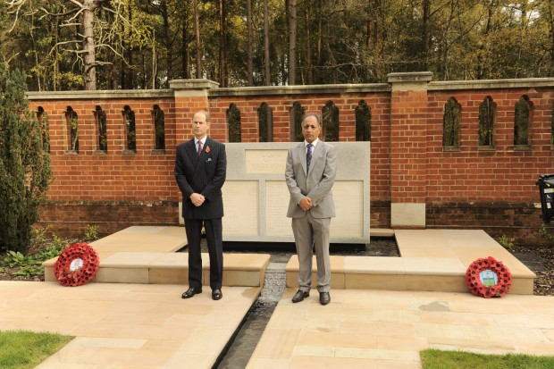 HRH The Earl of Wessex KG GCVO and Zafar Iqbal, Project Lead at Woking Borough Council, observe a one minute silence in front of the Peace Garden memorial stone.